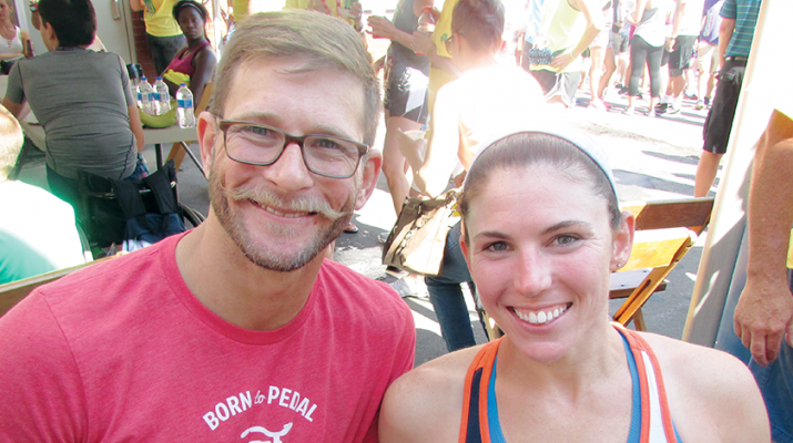 Amanda McCrory and her friend, Adam Finney, relax after McCrory won the Boilermaker's women's wheelchair division title for the fifth consecutive year and sixth time overall.