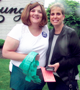 Jodi Deep, right, joins her friend Nicole Cocomazzi while buying raffle tickets at the cancer survivors breakfast at Hart's Hill Inn in Whitesboro recently.