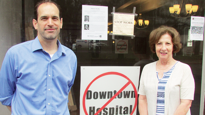 """Members of the No Downtown Hospital committee include Brett Truett and Donna Beckett, shown here at #NoDowntownHospital headquarters at 10-12 Liberty St., downtown Utica. They planned a multi-day event called """"Battle For Our City"""" beginning on June 26."""