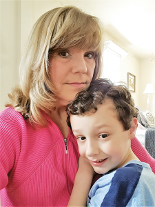 Kayci Visalli spends a tender moment with her autistic son, Isaiah.