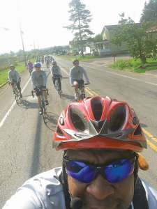 """Mark Montgomery, organizer and founder of Joseph's Experience, takes a """"selfie"""" with his cell phone camera showing the pack of bicyclists who participated in the 15-mile """"Joe's Ride"""" recently."""