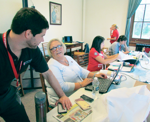Adam Hobb, left, disaster program manager, chats with Jane Gendron, executive director of the North Country chapter of the American Red Cross and coordinator of the training classes held recently at the Utica Public Library. To Gendron's left is Taylor Fanelli, who was keeping in touch with Red Cross officials in Texas in the aftermath of Hurricane Harvey.