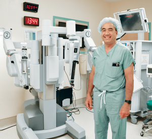 MVHS Medical Director for Robotic Surgery Jonathan Blancaflor, MD, FACS, stands beside the da Vinci® Si™ Surgical System at the St. Elizabeth Campus.