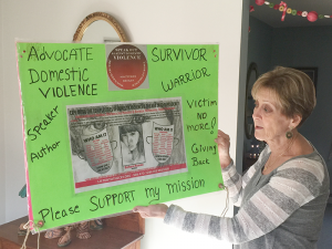 Barbara Joy Hansen displays her award-winning poster recognized during an Institute on Violence, Abuse & Trauma conference in San Diego, Calif. in 2012.