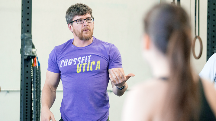Anthony Mucurio, left, owner and head coach of CrossFit Utica, takes charge during a recent training session.