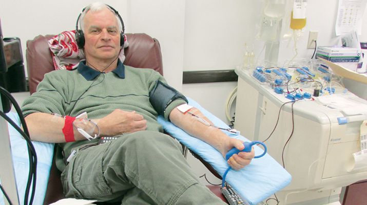 Tom O'Hara watches a video and listens to music while giving a donation of platelets at the Mohawk Valley Red Cross office in New Hartford. The process takes between two to three hours.
