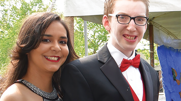 """The 2019 Tradewinds Education Center Prom held recently was a night to remember for more than 80 Tradewinds Education Center students of Upstate Cerebral Palsy. Welcomed by the grand marshal, Utica City School District Superintendent Bruce Karam, attendees experienced a magical night filled with dinner and dancing. Tradewinds students had the honor of creating all the decorations in their art classes to match the theme, """"Under the Sea."""" Above, Tradewinds Education Center student Nate VanDeusen walks the red carpet with staff person Katherine Castellar. For more information or to become involved with the 2020 Tradewinds Prom, contact Patti Carey, vice president of school-aged services at UCP, at 315-533-1150 ext. 2452."""