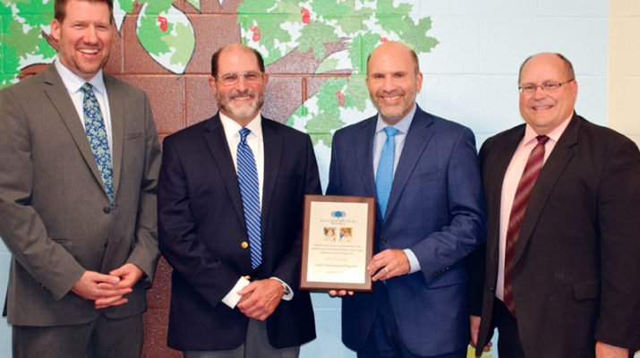 Scalzo, Zogby & Wittig, Inc. was recently recognized at a plaque presentation at Upstate Cerebral Palsy for its long-standing commitment to supporting the programs and services at the Upstate Caring Partners family of agencies. Both Stephen Zogby, executive vice president, and Gary Scalzo, president were present to accept this recognition for their long-term commitment to the agency as well as to their commitment to serving the youngest of children supported through the early intervention program. Celebrating the occasion are, from left, Jeremy Earl, UCP senior vice president of education; Scalzo and Zogby, and Geno DeCondo, UCP executive director. The insurance specialists have helped the family of affiliate agencies grow from its earliest of years.