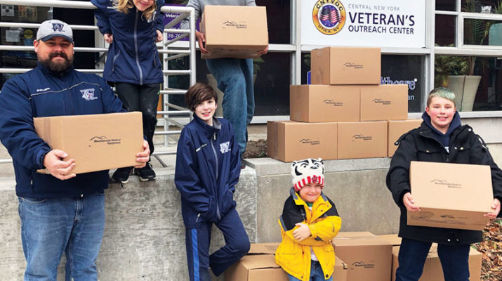 "To celebrate Giving Tuesday, Mountainside Medical Equipment and players and coaches of the Whitestown Wolfpack Pee Wee Hockey team created special care packages and hygiene kits to distribute to local veterans at the Central New York Veteran's Outreach Center in Utica. The Wolfpack assembled 150 kits of hygiene supplies for the Outreach Center, which operates a donation room that provides veterans and their families with necessary household items and medical supplies. The Whitestown Wolfpack, whose players are aged 10-12, regularly participate in charitable projects as a team. ""It's a chance for them to be part of something bigger than themselves and do it together,"" said Wolfpack head coach Eric Gulseth. Mountainside Medical Equipment is a family owned and operated business, and maintains a regular presence in the community, including local youth hockey events in Central New York. The Central New York Veteran's Outreach Center has been in operation since 2008 and is managed by the Utica Center for Development."