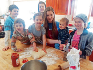 "Brian and Brooke DeMott homeschool their children, which makes for a smooth transition to quarantine in the face of the COVID-19 pandemic. Above, the children partake in a ""Life Skills"" class, making pizza from scratch. They are, from left, Judah, 10; Miriam, 3; Selah, 5; Malachi, 7; Stacia, 15; Enoch, 1; and Aliana, 11."