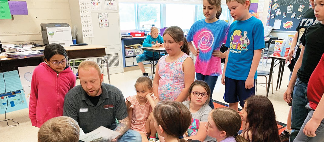Craig T. Brown, 4-H youth development resource educator, Cornell Cooperative Extension, Madison County, reads to program participants recently.