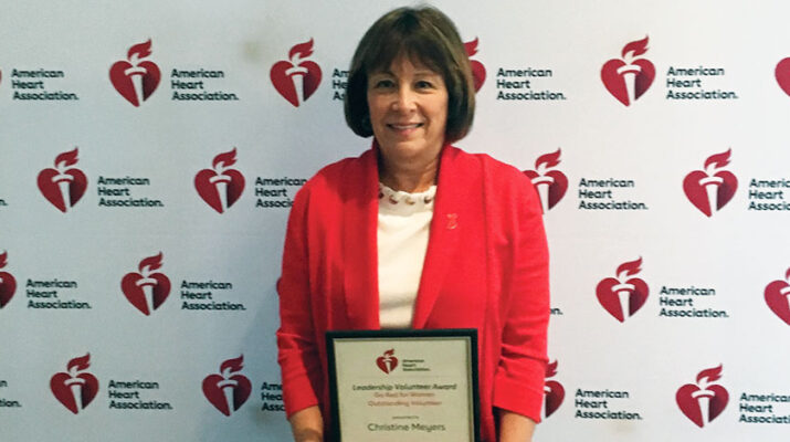 """Christine Meyers of Clinton receives recognition at the American Heart Association's """"Go Red For Women"""" luncheon."""