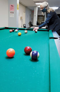 Rise RCOC has a pool table, fuseball, meditation room, craft room and ping pong table, among other recreational activities, for its members. Pictured above is peer advocate Jean Verri.